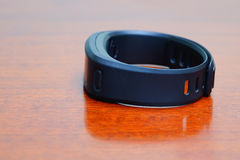 Close up of heart rate watch band on a table Royalty Free Stock Photo
