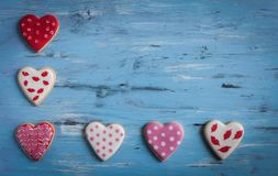 Heart shaped cakes on wooden background. Close-Up Of Heart Shape Cookies On Wooden Table background Royalty Free Stock Photography