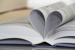 Close-up of heart shape from paper book. Love for reading royalty free stock photography