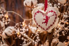 Heart shaped Christmas decoration. Blurry lights of garland on the background. stock photos