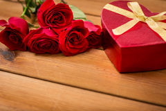 Close up of heart shaped gift box and red roses Royalty Free Stock Photo