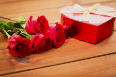 Close up of heart shaped gift box and red roses Royalty Free Stock Photography
