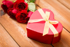 Close up of heart shaped gift box and red roses Stock Image