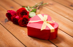 Close up of heart shaped gift box and red roses Stock Photos