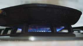Close up of heating up the frying pan on the stove in 4K stock video