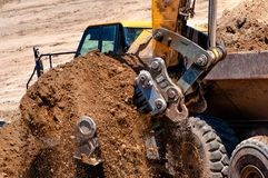 Close-up of heavy duty excavator full scoop Royalty Free Stock Images