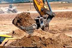 Close-up of heavy duty excavator scooping into earth Stock Photos
