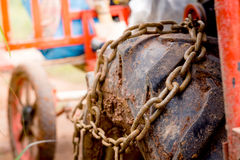 Close up heavy muck truck wheel off road car tire with chain o stock photo