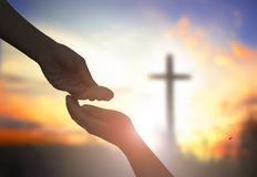 Close up helping and blessing pray hands try to give and take on blur beautiful sunrise sky background for support and healing lif royalty free stock photo