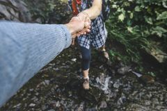 Close-up Of Helping Hand, Hiking Help Each Other. Focus On Hands. People Teamwork Hiking With Motivation And Inspiration. Wide ang. Helping hand. The concept of stock photo