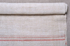 Close-up of the hemp homespun cloth with red stripe Royalty Free Stock Photography