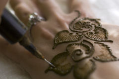 Close-up of henna. Close-up shot of henna being applied to back of hand stock photos