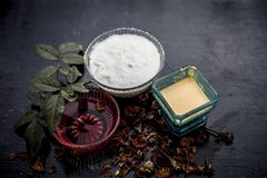 Close up of herbal and ayruvedic face pack of rose or Rosa or Rosaceae or gulab with its extracted rose water in a glass bowl. With gram flour and yogurt on stock images