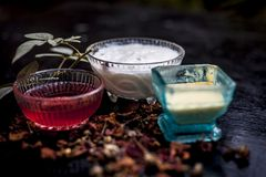 Close up of herbal and ayruvedic face pack of rose or Rosa or Rosaceae or gulab with its extracted rose water in a glass bowl. With gram flour and yogurt on royalty free stock photography