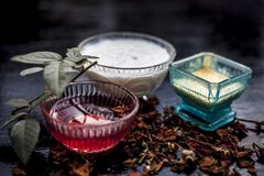 Close up of herbal and ayruvedic face pack of rose or Rosa or Rosaceae or gulab with its extracted rose water in a glass bowl. With gram flour and yogurt on royalty free stock photos
