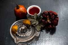 Close up of herbal and organic face pack of pomegranate with lemon juice on wooden surface for Sun tanning. stock photos