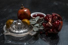 Close up of herbal and organic face pack of pomegranate with lemon juice on wooden surface for Sun tanning. royalty free stock image