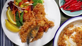King prawn risotto with salad and lemon being served on a plate stock video