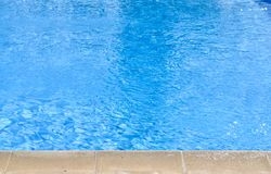 Close-up high angle view of blue  swimming pool at noon. Durign summer  time stock image
