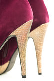 Close up of High Heels shoes in red and shiny gold Royalty Free Stock Photos