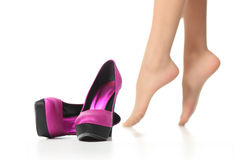 Close up of high heels beside woman feet. Isolated on a white background Royalty Free Stock Photography
