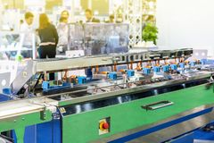 Close up high performance detect sensor for goods inspection on continue mass production line.  stock photography