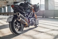 Close up of high power motorcycle on urban background at parking stock photography