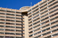 Close Up of High Rise Apartment Building Against Blue Sky Stock Photography