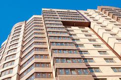 Close up of a high-rise building. Facade light brown high-rise building close up Royalty Free Stock Photography