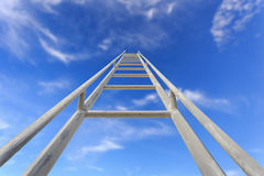 Close up high steel ladder on clear blue sky Stock Images