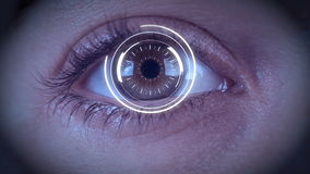 Close-up of high tech cyber eye with zoom into eye to black. Cyber eye with futuristic hud hologram