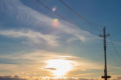 Close up of high voltage power lines on sunset background. Royalty Free Stock Image