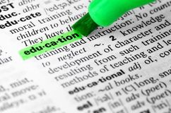 Close Up of Highlighting Specific Word Educiation. Education learning highlighter text green book studying Royalty Free Stock Photos