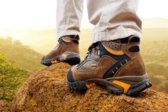Close up of hiker boots on rocks. Stock Photo