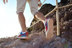 Close-up of hiker legs trekking along a rocky path Royalty Free Stock Photo