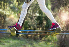 Close-up hiking boots in adventure park. Girl in adventure park Stock Images