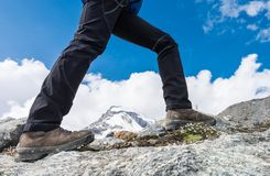 Close-up of hiking shoes on mountain ridge. Stock Photography
