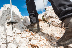 Close up of hiking shoes and trekking poles stock image