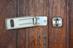 Close up hinge lock on wooden door background. Royalty Free Stock Photography