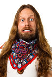 Close-up of a hippie man with a crazy expression. Stock Photography