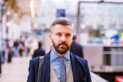Close up, hipster businessman waiting at the train station Royalty Free Stock Photography