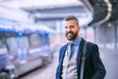 Close up, hipster businessman waiting at the train station Stock Photography