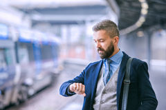 Close up, hipster businessman waiting at the train station Royalty Free Stock Photos
