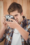 Close-up of hipster photographing Stock Images