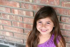 Close up of Hispanic little girl smiling Royalty Free Stock Image