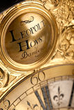 Close-up of historic gold and black clock Stock Image