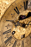 Close-up of historic gold and black clock Royalty Free Stock Photo