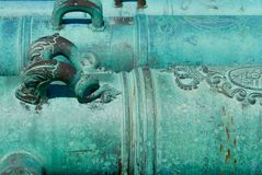 Close up of historic, ornate, turquoise cannons royalty free stock images