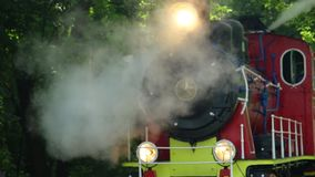 Close up of historic retro steam train in the forest.  stock footage