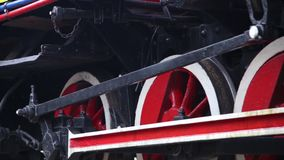 Close up of historic retro steam train wheels. Retro concept stock footage